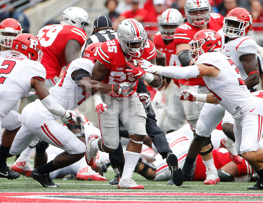 Ohio State Buckeyes running back Mike Weber (25) runs through Rutgers Scarlet Knights linebacker Tyreek Maddox-Williams (44) and defensive back Anthony Cioffi (31) during the first half of the NCAA football game at Ohio Stadium in Columbus on Oct. 1, 2016. (Adam Cairns / The Columbus Dispatch)