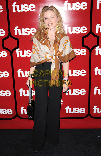 CASEY JOHNSON.Attends The 2008 Fuse TV Pre-Grammy Celebration & Concert held at Goa in Hollywood, California, USA, .full length shawl scarf tied wrap gold brown print black bag trousers wide leg cuff bracelet                                                                                 .CAP/RKE/DVS.©DVS/RockinExposures/Capital Pictures.