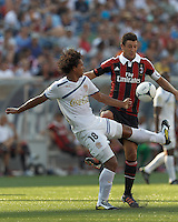 C.D. Olimpia forward Douglas Caetano (18) attempts to control the ball as AC Milan defender Daniele Bonera (25) defends. In an international friendly, AC Milan defeated C.D. Olimpia, 3-1, at Gillette Stadium on August 4, 2012.