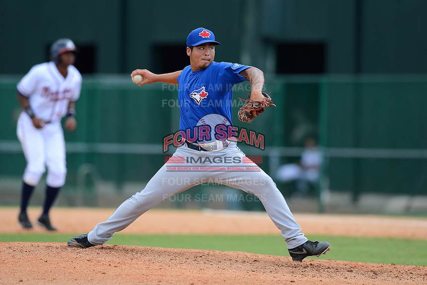GCL Blue Jays pitcher Kamakani Usui (71) during a game against the GCL Braves on July 15, 2013 at Disney's Wide World of Sport in Orlando, Florida.  The game was called in the 4th inning due to rain storms with the Braves leading 5-0.  (Mike Janes/Four Seam Images)