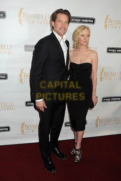 James Tupper, Anne Heche.12th Annual Beverly Hills Film Festival Opening Night held at the AMPAS Samuel Goldwyn Theater, Beverly Hills, California, USA..April 25th, 2012.full length black suit dress strapless couple .CAP/ADM/BP.©Byron Purvis/AdMedia/Capital Pictures.