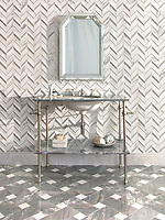 Thomas, a hand-cut stone mosaic, shown in venetian honed and honed Calacatta Tia with Basketweave Grand, a hand-cut stone mosaic, shown in polished Dolomite and Argent Blue. Thomas is part of the Tissé™ collection for New Ravenna.