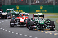 MELBOURNE, 17 MARCH - Giedo van der Garde (NLD) from the Caterham F1 Team goes through turn one ahead of a group of cars in the 2013 Formula One Rolex Australian Grand Prix at the Albert Park Circuit in Melbourne, Australia. Photo Sydney Low/syd-low.com