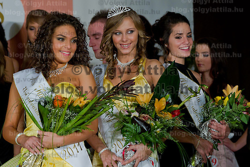 Edina Szommer (C) winner of the contest poses with Jenifer Illyes (L) and Muzsa Kalvari (R) runner ups of the Teen Miss Hungary beauty contest held in Budapest, Hungary on December 29, 2011. ATTILA VOLGYI