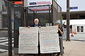 "James Germalic, left and Lenore Kalam of Cleveland, Ohio, representing ""The Black / White Party"" carry signs outside the Quicken Loans Arena, site of the 2016 Republican National Convention on Saturday, July 16, 2016.  Their religious party rejects both Donald Trump and Hillary Clinton.<br /> Credit: Ron Sachs / CNP<br /> (RESTRICTION: NO New York or New Jersey Newspapers or newspapers within a 75 mile radius of New York City)"