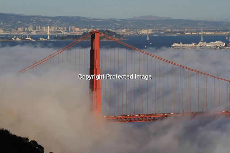 The autumn fog rolls through the Golden Gate Bridge underlining the San Francisco skyline.