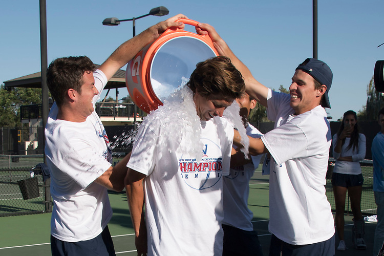 April 29, 2017; Claremont, CA, USA; San Diego Toreros men's tennis team coach Ryan Keckley and players during the WCC Tennis Championships at Biszantz Family Tennis Center.