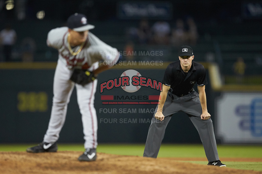 Umpire Evin Johnson keeps an eye on Rome Braves starting pitcher Victor Vodnik (11) during the game against the Columbia Fireflies at Segra Park on May 13, 2019 in Columbia, South Carolina. The Fireflies defeated the Braves 6-1 in game two of a doubleheader. (Brian Westerholt/Four Seam Images)