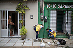 RECIFE, BRAZIL - JANUARY 9:  Workers from the Environmental Health Department investigate a water line under the sidewalk in a residential community, in Recife, Brazil, on Saturday, Jan. 9, 2016. Workers go door to door encouraging and educating residents about how to clean up standing water, which provides perfect breeding ground for the zika-carrying mosquitoes.<br /> <br /> The mosquito-borne Zika virus continues to spread in Brazil, alarming health officials and expecting mothers that their babies will be born with abnormal brain development called microcephaly. While researchers have yet to make a connection, Brazil has the highest number of babies born with mircocephaly - the most cases in Recife, Pernambuco - from mothers who tested positive to the Zika virus. There are about 3,530 suspected cases of zika-related microcephaly in Brazil.