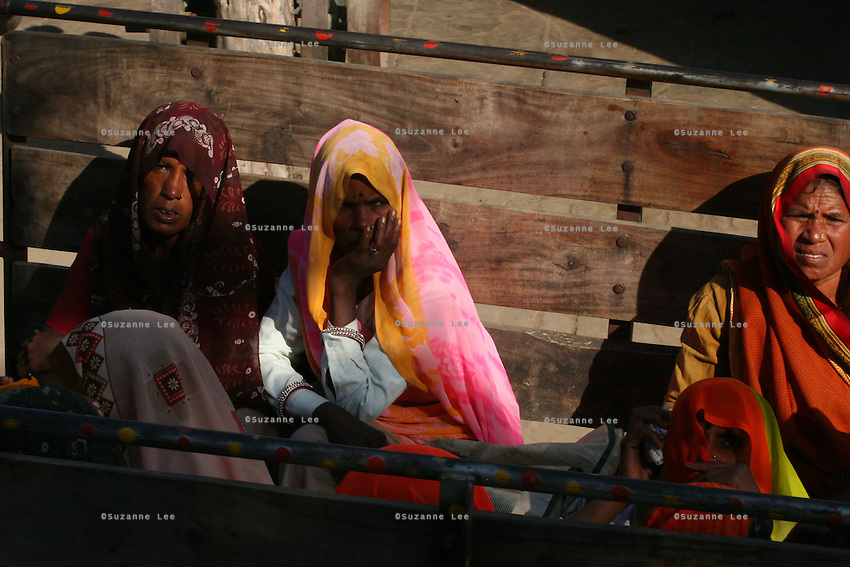 Rural village farming women riding in the back of a lorry in Bharatpur, Rajasthan, India..Photo by Suzanne Lee