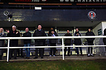 Spectators watching the action during the second-half as Gala Fairydean Rovers host Gretna 2008 in a Scottish Lowland League match at Netherdale, Galashiels. The home club were established in 2013 through a merger of Gala Fairydean, one of Scotland's most successful non-League clubs, and local amateur club Gala Rovers. The visitors were a 'phoenix' club set up in the wake of the collapse of the original club, which had competed for a short time in the 2000s before going bankrupt. The home aside won this encounter 4-1 watched by a crowd of 120 at a stadium which features one of the country's most notable stands, a listed building constructed in 1964 but at the time of this fixture closed to spectators on safety grounds.