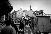 Rostock, Germany  .1998.Shoppers in the center of a city which once stood dark and colorless along the Northern sea front. Today most of the buildings have been completely repaired and the center is almost as nice as any city in Austria..