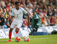 Kyle Walker-Peters (Tottenham Hotspur) of England plays on despite 2 balls being on the field during the International match between England U20 and Brazil U20 at the Aggborough Stadium, Kidderminster, England on 4 September 2016. Photo by Andy Rowland / PRiME Media Images.