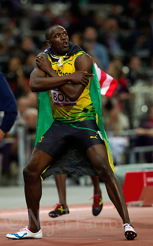 05 AUG 2012 - LONDON, GBR - Usain Bolt (JAM) of Jamaica celebrates winning the men's 100m final during the London 2012 Olympic Games athletics at the Olympic Stadium in Stratford, London, Great Britain (PHOTO (C) 2012 NIGEL FARROW)