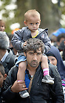 A father and son wait to walk through the Hungarian town of Hegyeshalom on their way to the border where they will cross into Austria. Hundreds of thousands of refugees and migrants flowed through Hungary in 2015, on their way from Syria, Iraq and other countries to western Europe.