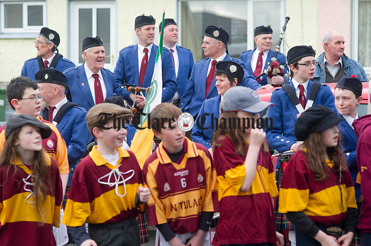 Members of the Tulla Pipe Band and Tulla GAA awaiting the start of the St Patrick's Day Parade in Tulla. Photograph by Declan Monaghan