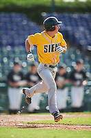 Siena Saints shortstop Rich Gilbride (5) runs to first base during a game against the Pittsburgh Panthers on February 24, 2017 at Historic Dodgertown in Vero Beach, Florida.  Pittsburgh defeated Siena 8-2.  (Mike Janes/Four Seam Images)