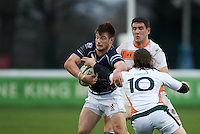 George Horne of London Scottish Football Club is tackled by Tristan Roberts of Ealing Trailfinders during the Greene King IPA Championship match between London Scottish Football Club and Ealing Trailfinders at Richmond Athletic Ground, Richmond, United Kingdom on 26 December 2015. Photo by Alan  Stanford / PRiME Media Images