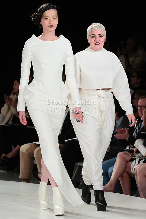 Graduating fashion student Raya Kassisieh, walks runway with model at the close of the 2013 Pratt Institute Fashion Show, on April 25, 2013.