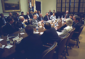 United States President George W. Bush meets with his Homeland Security Council and other senior staff members to discuss the Department of Homeland Security. The meeting took place in the Roosevelt Room of the White House in Washington, D.C. Thursday morning, June 6, 2002.  From left to right: United States Secretary of Health and Human Services Tommy Thompson, United States Vice President Dick Cheney, President Bush United States Secretary of State Colin Powell, United States Secretary of Commerce Don Evans, United States Secretary of Labor Elaine Chao, United States Federal Emergency Manpower Administrator Joe Allbaugh, unidentified, United States Attorney General John Ashcroft, and Homeland Security Advisor Tom Ridge.<br /> Mandatory Credit: Tina Hager / White House via CNP