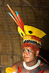 Retrato de &iacute;ndio Kalapalo pintado e com Tucanap (cocar) para festa do Kuarup na Aldeia Aiha no Parque Ind&iacute;gena do Xingu | Portrait of Kalapalo man painted and with Tucanap (headdress) to Kuarup party at Aiha Village in the Xingu Indigenous Park<br /> <br /> LOCAL: Quer&ecirc;ncia, Mato Grosso, Brasil <br /> DATE: 07/2009 <br /> &copy;Pal&ecirc; Zuppani