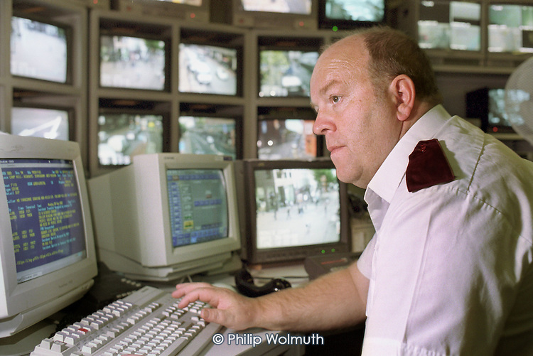Civilian West Midlands Police Service staff working in the CCTV Operation Centre at Steelhouse Lane Police Station, Birmingham.