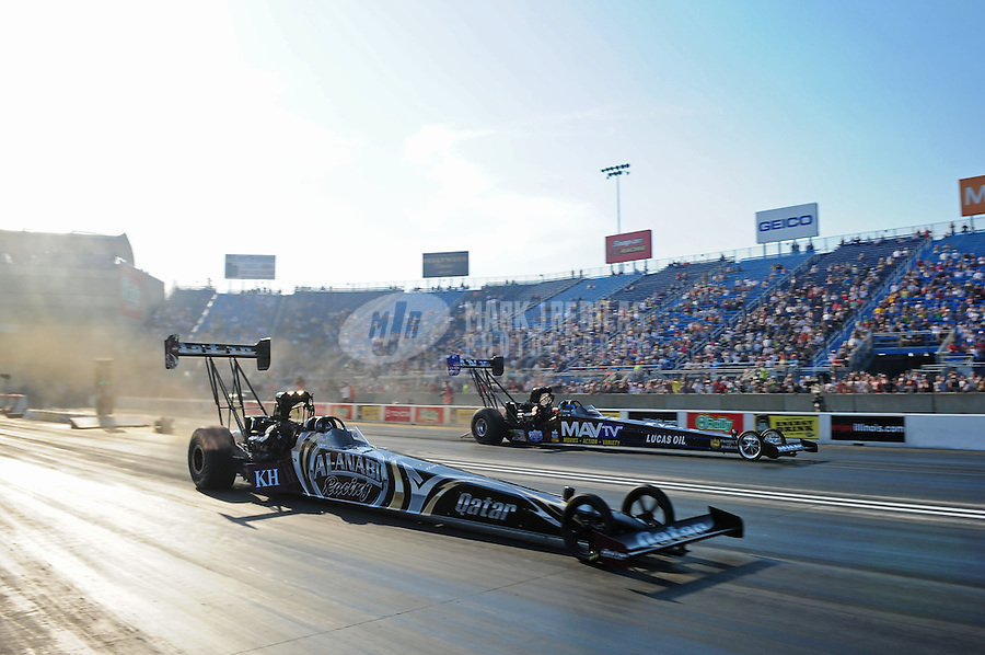 Jun. 29, 2012; Joliet, IL, USA: NHRA top fuel dragster driver Shawn Langdon (near) races alongside Brandon Bernstein during qualifying for the Route 66 Nationals at Route 66 Raceway. Mandatory Credit: Mark J. Rebilas-
