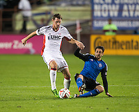 Santa Clara, California -Saturday, March 29, 2014: Andy Dorman of NE Revolution controls the ball while being tackled by Jean-Baptiste Pierazzia of SJ Earthquakes during a match at Buck Shaw Stadium. Final Score: SJ Earthquakes 1, NE Revolution 2