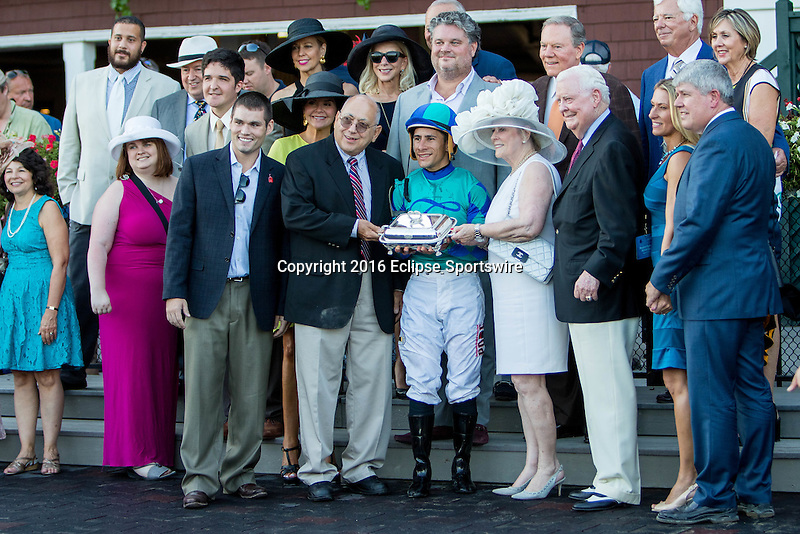SARATOGA SPRINGS - AUGUST 27: Jockey Junior Alvarado poses for a photo with the connections after winning the Woodford Reserve Ballston Spa Stakes on Travers Stakes Day at Saratoga Race Course on August 27, 2016 in Saratoga Springs, New York. (Photo by Sue Kawczynski/Eclipse Sportswire/Getty Images)