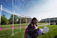 Essence Briggs, a freshman psychology major from Pine Bluff, Arkansas, stretches her &quot;identity yarn&quot; between posts on the Drill Field as part of an interactive public art project sponsored by the Holmes Cultural Diversity Center and Department of Health Promotion and Wellness. The UNITY Project is one of many ways MSU is marking April as Unity Month.<br />