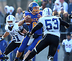 BROOKINGS, SD - NOVEMBER 9:  Austin Sumner #6 from South Dakota State University looks for a receiver while being pressured by Mark Sewall #21 and Russell Jones #53 from Indiana State University Saturday at Coughlin Alumni Stadium. (Photo by Dave Eggen/Inertia)