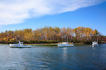 Lobster boats at rest on a sunny autumn morning in Kennebunkport Harbor, Kennebunkport, Maine, USA