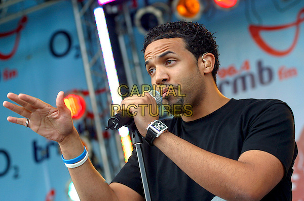 CRAIG DAVID.Performs live in concert at 96.4 BRMB's Party In The Park, Cannon Hill Park, Birmingham, .July 3rd 2005..half length gig jeans black t-shirt hand white blue rubber bracelets.Ref: JEZ.www.capitalpictures.com.sales@capitalpictures.com.©Jez Self/Capital Pictures