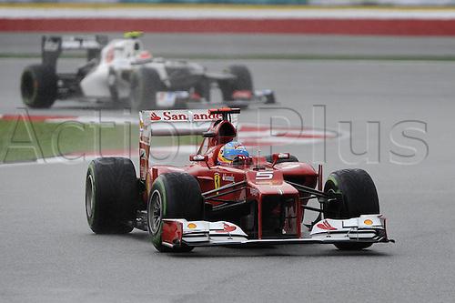 25.03.2012. Kuala Lumpur Malaysia. Formula 1 GP Malaysia in Kuala Lumpur  Fernando Alonso ESP Ferrari in front of Sergio Perez MEX clean F1 team