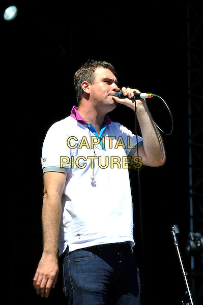 Jon McClure of Reverend and the Makers.performing at V Festival, Hylands Park, Chelmsford, Essex, England. .18th August 2012.on stage in concert live gig performance music half length white top profile singing  .CAP/MAR.© Martin Harris/Capital Pictures.