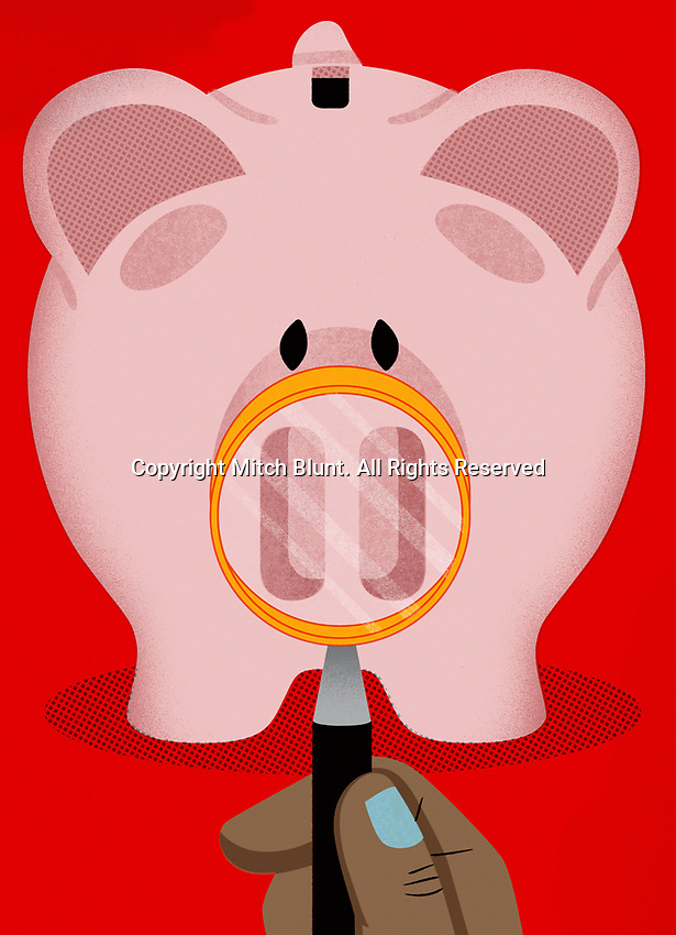 Magnifying glass examining piggy bank ExclusiveImage
