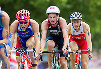 07 AUG 2012 - LONDON, GBR - Jonathan Brownlee (GBR) of Great Britain (centre, in dark blue and white) rides in the lead pack during the men's London 2012 Olympic Games Triathlon in Hyde Park, London, Great Britain (PHOTO (C) 2012 NIGEL FARROW)
