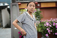 A young girl in a small town in western Sichuan Province, China.