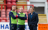 Wycombe Wanderers Manager Gareth Ainsworth with Wycombe Wanderers Assistant Manager Richard Dobson (centre) & Goalkeeper / Coach Barry Richardson (left) of Wycombe Wanderers during the Sky Bet League 2 match between Leyton Orient and Wycombe Wanderers at the Matchroom Stadium, London, England on 1 April 2017. Photo by Andy Rowland.