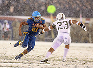 Philadelphia, PA - December 9, 2017:  Navy Midshipmen running back Malcolm Perry (10) tries to avoid the tackle   during the 118th game between Army vs Navy at Lincoln Financial Field in Philadelphia, PA. (Photo by Elliott Brown/Media Images International)