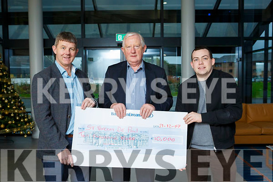 Frank Hayes (Director of Corporate Affairs Kerry Group) presenting Junior Locke of the Tralee branch of St Vincent de Paul with a cheque. L to r, Junior Locke, Frank Hayes & Paddy Kevane.