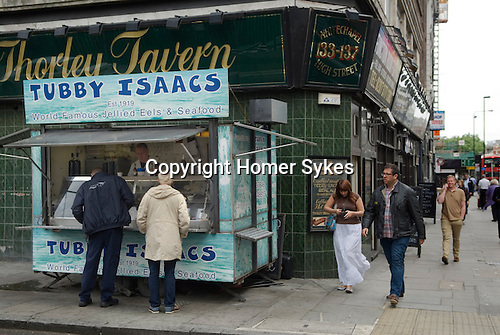 Tubby Isaacs Seafood and Jellied Eel stall. Their last day of reading. Aldgate London UK