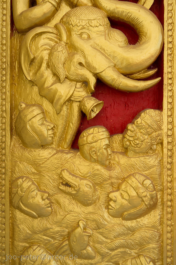 wooden relief, painted gold, on door of Buddhist temple in Vietiane, Laos, 2012