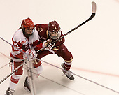 Victoria Bach (BU - 12), Megan Keller (BC - 4) - The Boston College Eagles defeated the Boston University Terriers 3-2 in the first round of the Beanpot on Monday, January 31, 2017, at Matthews Arena in Boston, Massachusetts.