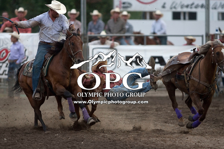 25 Aug 2011:  Tommy Cook from McAlester, OK scored a time of 6.1 in the Steer Wrestling competition at the Kitsap County Fair and Stampede Rodeo in Bremerton, Washington.
