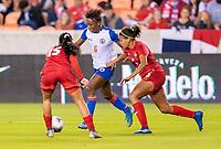 HOUSTON, TX - FEBRUARY 3: Melchie Dumonay #6 of Haiti is defended by Yerenis De Leon #6 of Panama during a game between Panama and Haiti at BBVA Stadium on February 3, 2020 in Houston, Texas.