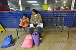 Eulalia Miguel and son Cristopher wait for a bus in the Greyhound station in San Antonio, Texas, on December 2, 2015. Miguel and her son fled Guatemala in 2015 because of domestic violence. After requesting political asylum in the United States, they were held for several days by immigration officials and then released, after which they stayed in a shelter run by the Refugee and Immigrant Center for Education and Legal Services (RAICES), and supported by a coalition of San Antonio churches. After that, they traveled by bus to a new location in the United States, where they will live pending a final decision on her request for asylum. The coloring book being used by Christopher was included in a backpack of materials provided by the Interfaith Welcome Coalition.