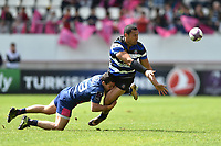 Robbie Fruean of Bath Rugby offloads the ball after being tackled. European Rugby Challenge Cup Semi Final, between Stade Francais and Bath Rugby on April 23, 2017 at the Stade Jean-Bouin in Paris, France. Photo by: Patrick Khachfe / Onside Images