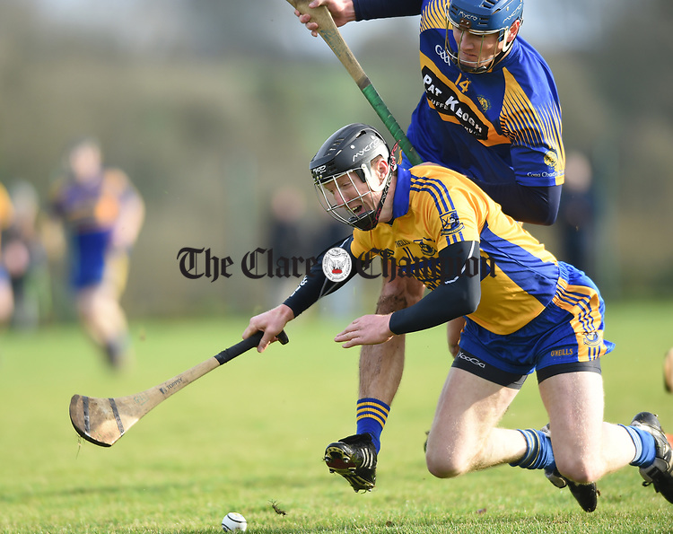 Niall Gilligan of  Sixmilebridge  in action against Mike Mc Inerney of Newmarket during their Clare Champion Cup final at Clonlara. Photograph by John Kelly.