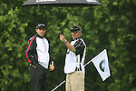 Peter Lawrie (IRL) and caddy Brian take shelter from the rain on the 6th green during Day 1 of the BMW International Open at Golf Club Munchen Eichenried, Germany, 23rd June 2011 (Photo Eoin Clarke/www.golffile.ie)